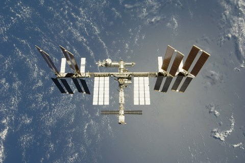 Framed International Space Station Backdropped against Earth Print
