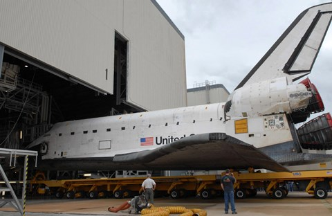 Framed Space Shuttle Atlantis Rolls out of Orbiter Processing Facility 1 at Kennedy Space Center Print