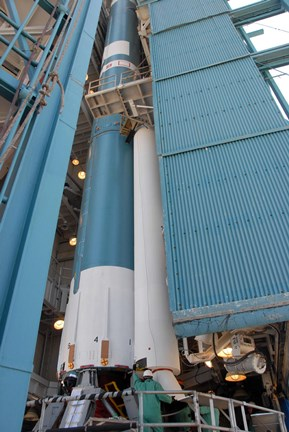 Framed Second Solid Rocket Motor is Moved into Place Alongside the Delta II First Stage Print