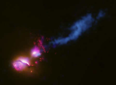 Framed Powerful Jet from a Supermassive Black Hole is Blasting a nearby Galaxy Print