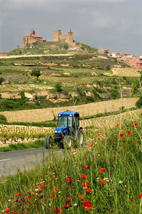 Framed Blue tractor on rural road, San Vicente de la Sonsierra Village, La Rioja, Spain Print