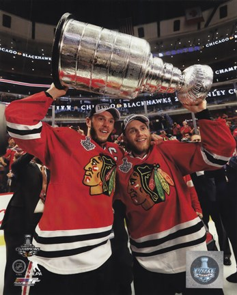 Framed Jonathan Toews & Patrick Kane with the Stanley Cup Game 6 of the 2015 Stanley Cup Finals Print