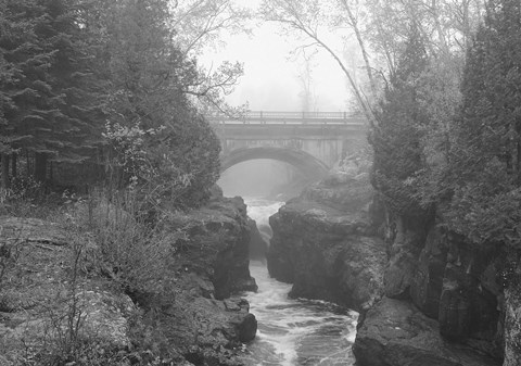 Framed Bridge Over Rocks Black And White Print