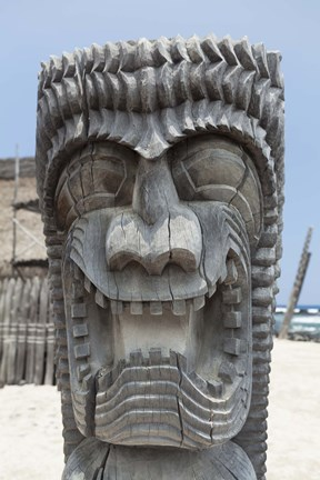 Framed Wooden Tiki Statue on Beach Print