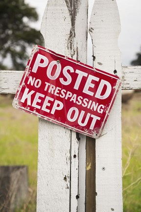 Framed Red No Treaspassing Sign on a Fence Post Print