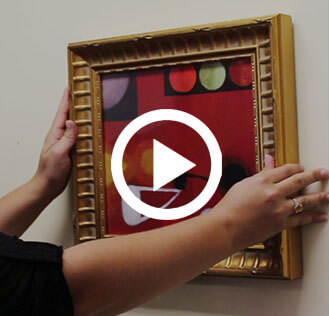 how to hang framed artwork