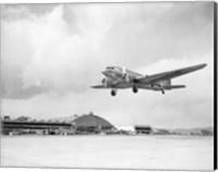 Low angle view of a military airplane landing, Douglas DC-3 Fine Art Print