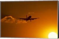 Silhouette of airliner in golden sunset Fine Art Print