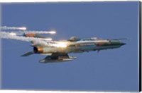 Romanian Air Force MiG-21 MF LanceR popping flares Fine Art Print