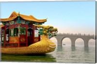 The Summer Palace, a traditional Dragon Boat passes the Seventeen Arch Bridge, Kunming lake, Beijing, China Fine Art Print