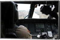 A UH-60 Blackhawk flies the River to an Unknown Village to Drop off a Care Package Fine Art Print