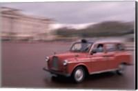 Cab racing past Buckingham Palace, London, England Fine Art Print