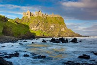 Sunrise Over Dunluce Castle Along Northern Coast Of County Antrim, Northern Ireland Fine Art Print