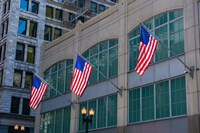 Flags Hanging Outside An Office Building, Chicago, Illinois Fine Art Print