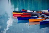 Colorful Rowboats Moored In Calm Lake, Alberta, Canada Fine Art Print