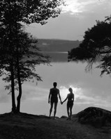 Man And Woman In Bathing Suits Holding Hands Watching Sunset Lakeside Fine Art Print