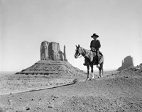 Navajo Indian In Cowboy Hat On Horseback With Monument Valley Rock Formations In Background Fine Art Print