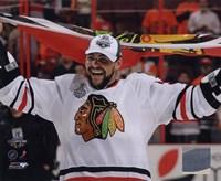 "Dustin Byfuglien with Chicago Blackhawks Flag 2010 Stanley Cup Finals (#35) - 10"" x 8"" - $12.99"