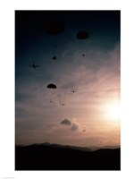 Supplies being dropped from C-141B Starlifters - various sizes