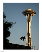 Skateboarder Aloft and Space Needle