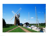 Boat moored near a traditional windmill, River Ant, Norfolk Broads, Norfolk, England - various sizes