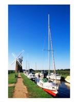 Boats moored near a traditional windmill, Horsey Windpump, Horsey, Norfolk Broads, Norfolk, England - various sizes