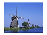 Windmills along a river, Kinderdike, Amsterdam, Netherlands Fine Art Print