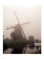Windmill and Cyclist, Zaanse Schans, Netherlands black and white Fine Art Print