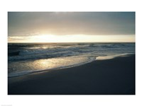 Waves breaking on the beach at sunrise Fine Art Print