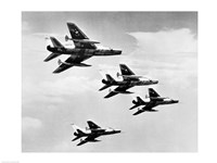 Low angle view of four fighter planes flying in formation, F-100 Super Sabre - various sizes