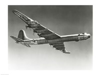 Low angle view of a fighter plane in flight, Convair B-36D - various sizes