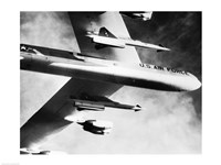 Low angle view of a bomber plane carrying missiles during fight, AGM-28 Hound Dog, B-52 Stratofortress Fine Art Print