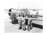 Rear view of four soldiers standing near a fighter plane, T-6 Texan - various sizes