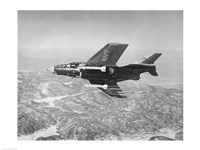 Side profile of a fighter plane carrying sidewinder missiles during flight, F9F-8 Cougar, US Navy - various sizes