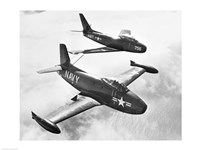 High angle view of two fighter planes in flight - various sizes