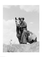 Cowboy on top of escarpment - various sizes