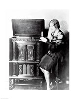 Young woman sitting beside an RCA Radio-Phonograph and Home Recorder - various sizes
