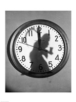 Close-up of the shadow of a person carrying a scythe on a clock Fine Art Print