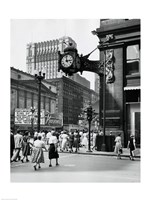 Clock mounted on the wall of a building, Marshall Field Clock, Marshall Field and Company, Chicago, Illinois, USA Framed Print