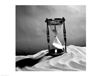 Close up of hourglass on sand Fine Art Print