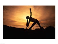 Silhouette of a young woman practicing yoga, Haleakala, Maui, Hawaii, USA Fine Art Print