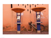 Public telephone booths in front of a wall, Morocco Fine Art Print