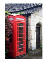Telephone booth outside a house, Castle Combe, Cotswold, Wiltshire, England Framed Print