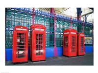 Four telephone booths near a grille, London, England Fine Art Print