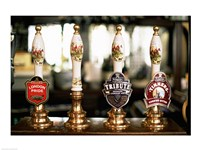 Close-up of beer tap handles in a bar, London, England Fine Art Print