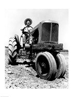 Farmer Sitting on a Tractor in a Field Fine Art Print