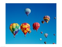 Low angle view of a group of hot air balloons in the sky - various sizes