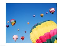 View of Hot Air Balloons Flying into the Sky in New Mexico - various sizes