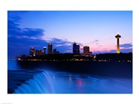 Waterfall with buildings lit up at dusk, American Falls, Niagara Falls, City of Niagara Falls, New York State, USA Fine Art Print