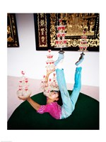 Acrobat balancing glasses, Shanghai, China Fine Art Print